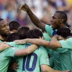 Barcelona's Keita is congratulated by team mates, including Abidal, after scoring a goal against Levante during their Spanish first division soccer match in Valencia